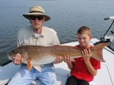 This giant redfish was caught by my 12 year old son Dylan. My dad had to help him hold the fish for the picture. The fish was taken on blue crab and light tackle. We were fishing the Indian River LAgoon near Titusville Florida. Dylan has now caught 6 redfish over 35 lbs since he was 8 years old.