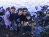 This is a photo of my husband Robert, son Javin, Son Robert jr, daughter Aiyana. Caught a bass in stockton,ca delta. It was about a four pound fish.