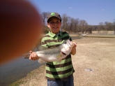 Jacob, who was ten years old when he landed this 23 inch largemouth bass on a four inch slider worm.  His excited dad's finger almost ruined his picture.