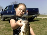 this is her first bass of 2011 and there will be alot more because she loves it more than anything and i have to say it because she makes me Bill Dance is her and her dads favorite fisher!!