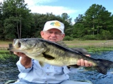 This is my grandfather Carl Hattabaugh. This is his monster 14lbs largemouth. Last cast of the day....