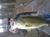 Cal Lane's 5 1/2 lb. largemouth on first cast.