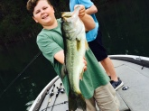 Cy Casey fishing with his cousin and Papa at Clark Hill shows his 5 lb. bass he caught on a jig.
