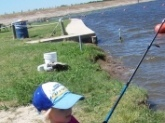 Elizabeth at 5yrs old learning to cast her first spinning rod. She was throwing soft plastics. We practice in the yard before we go to the lake.