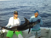 My name is Jonathan Ellington (White Shirt) and Deck hand Freddie (blue Shirt) Catch- Striped Marlin - (Catch and Release) Place- Cabo San Lucas Date- 8-1-2016 Time: 10:00