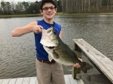 This is my 14 year old son (Max)He is brand new at fishing and landed this 8lbs 3oz Largmouth at a Private lake in Georgia...