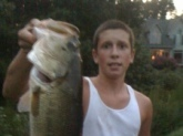 Caught a 6 pound bass using a plastic brown and orange colored worm that had a pink tail. I caught him in Matthew's Lake in the neighborhood of Marydale.      Now, I caught him by reeling in my worm while twitching it every two to three feet. I was using a Carolina rig for a better hook set. So he when he bit it, I yanked it right in the top corner of his cheek. He was a beauty.