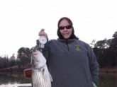 Lake Oliver, Columbus, GA 10 lb striper caught Jan 13, 2010 on a blue/black Booyah Boogie Bait using 10 lb test.  My first catch on my new Quantum IM8 Code combo.  Thanks Bill for showing me how it's done!